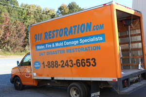 Water Damage Restoration Truck At Job Site